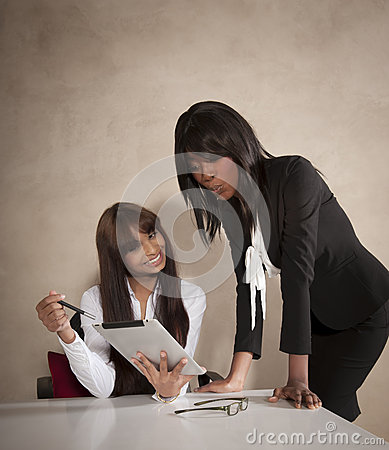 Two young business executives working at desk