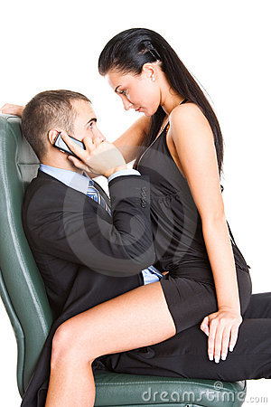 Two young business people in office relaxed