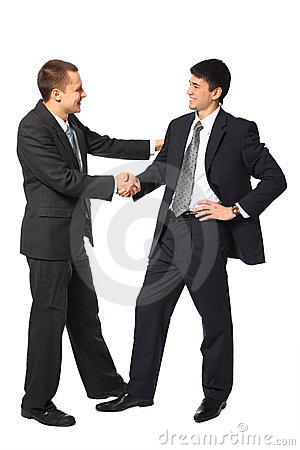 Two young businessmen greet