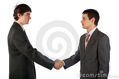 Two young businessmen handshake