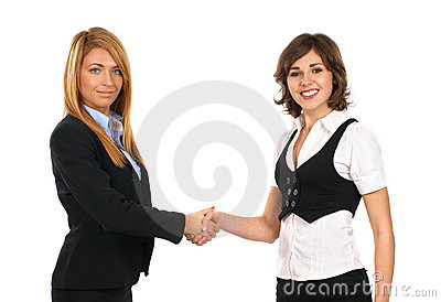 Two young businesswomen are shaking their hands