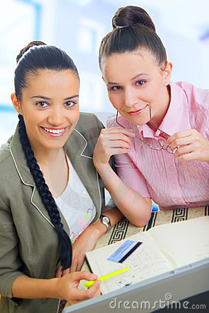 Two young businesswomen working