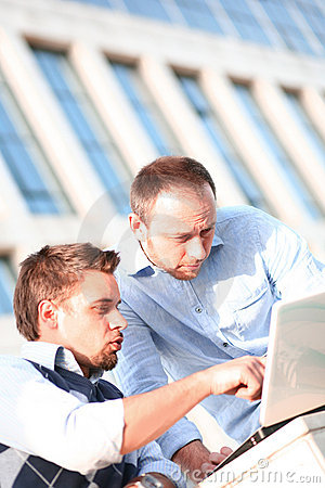 Two young college using laptop