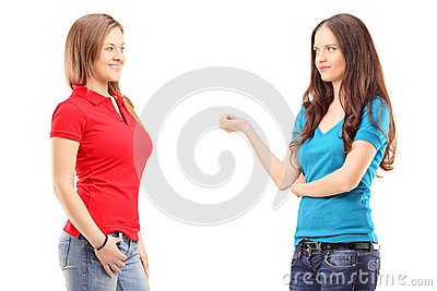Two young females having a conversation