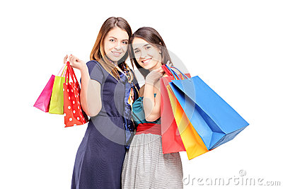 Two young females posing with shopping bags
