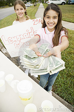 Free Two Young Girls At A Lemonade Stand Royalty Free Stock Photo - 67237095