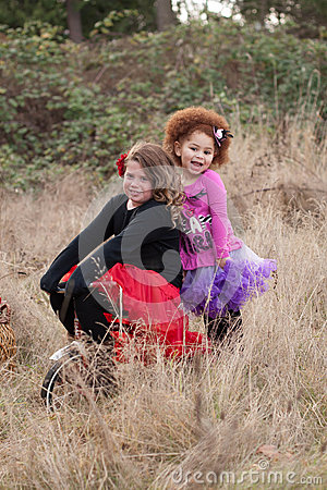 Two young girls on bike
