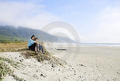Two young girls enjoying the beach