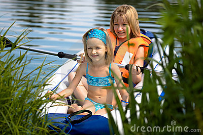 Two young girls at a lake