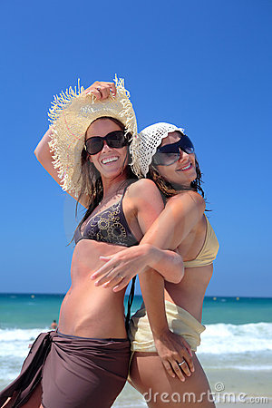 Free Two Young Girls Or Friends Playing On A Sunny Beach On Vaca Royalty Free Stock Photo - 1823185