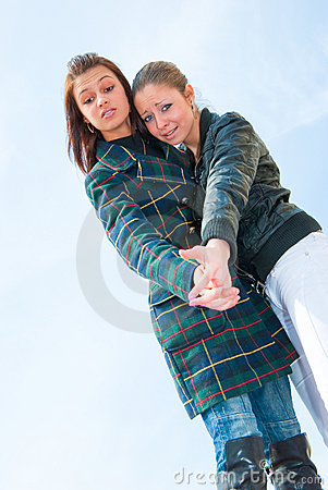 Free Two Young Girls Portrait Over Sky Royalty Free Stock Images - 9505789