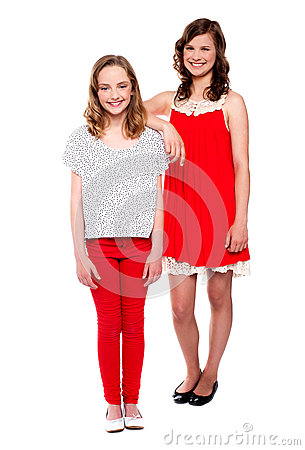 Two young girls posing. Full length shot