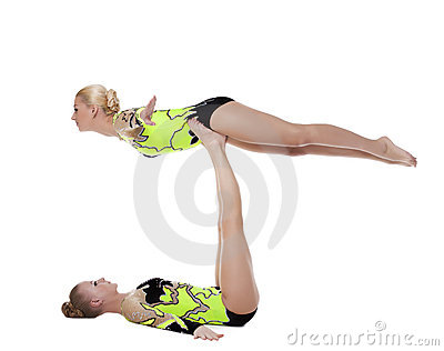 Two young gymnasts in green show exercise isolated