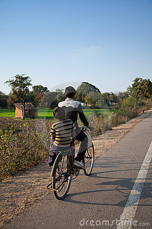Two young indian boys on bicycles Editorial Image