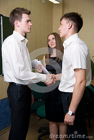 Two young men shake each other hands