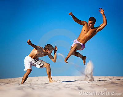 Two young men sport fighting