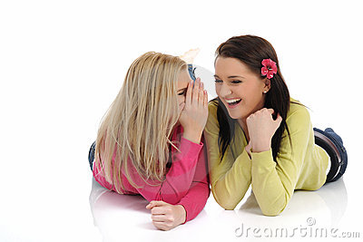 Two young pretty girls gossiping