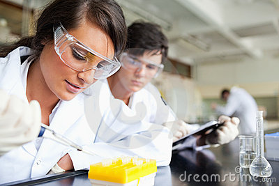 Two young scientists making an experiment