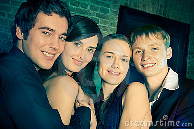 Two young smiling couples or friends at a Party