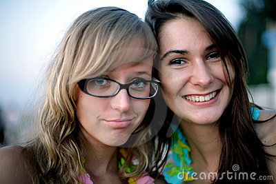 Two young smiling girls portrait