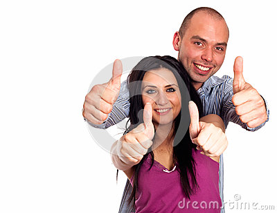 Two young smiling people with thumbs-up gesture isolated on whit