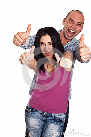 Two young smiling people with thumbs-up