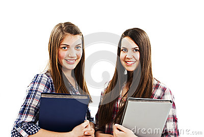 Two young students holding a book and smiling