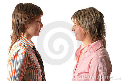 Two young talking  woman