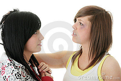 Two young teens (sisters) fighting