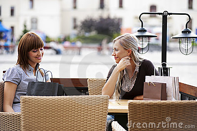 Two young woman chatting