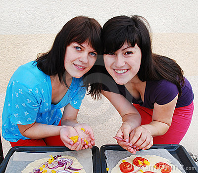 Two young woman cooking