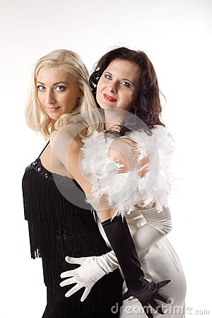 Two young woman in white and black feather boa
