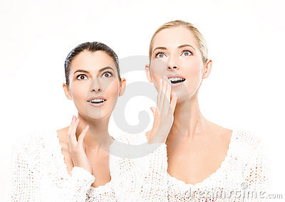 Two young women amazed