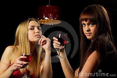 Two young women in a bar.