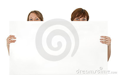 Two young women behind a blank banner ad