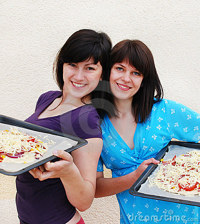 Two young women cooking