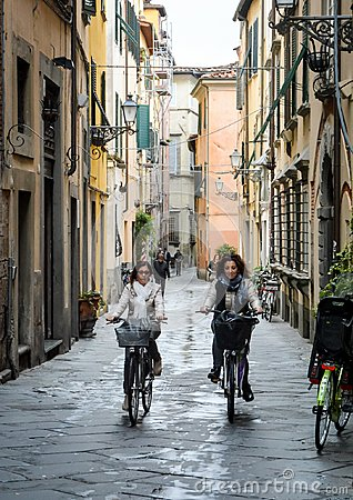Free Two Young Women Cycling In Lucca, Italy Royalty Free Stock Photography - 109174267