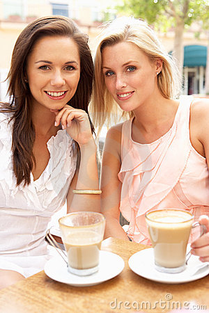 Free Two Young Women Enjoying Cup Of Coffee Royalty Free Stock Photos - 16613968