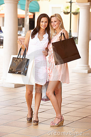 Two Young Women Enjoying Shopping