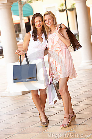 Two Young Women Enjoying Shopping Trip