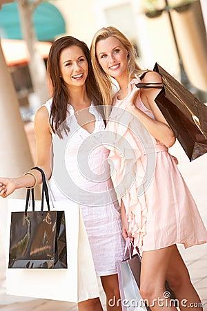Two Young Women Enjoying Shopping Trip