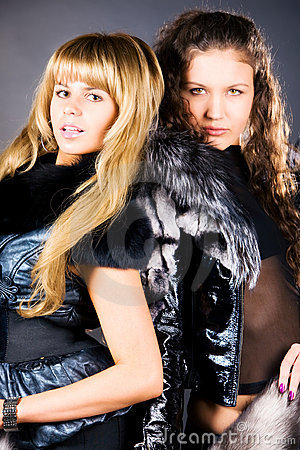Two young women with fur coats