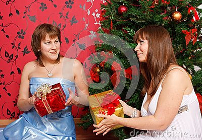 Two young  women with gifts