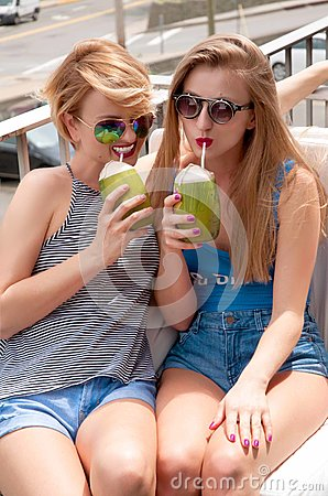 Free Two Young Women Having Fun And Drinking Cocktail In Summer Day Royalty Free Stock Image - 93829206