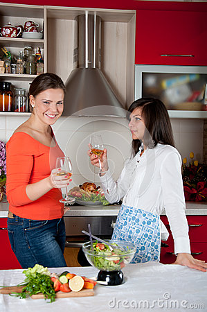 Two young women in modern kitchen