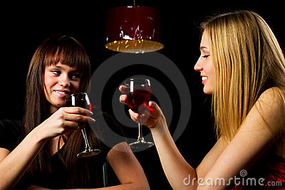 Two young women in a night bar