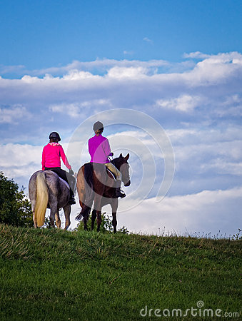Free Two Young Women Riding Horses Stock Photography - 55183882