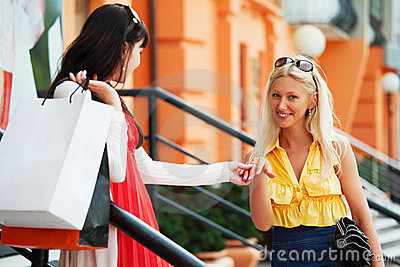 Two young women shopping.
