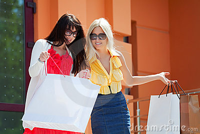 Two young women shopping