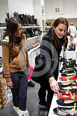 Two young women shopping for shoes